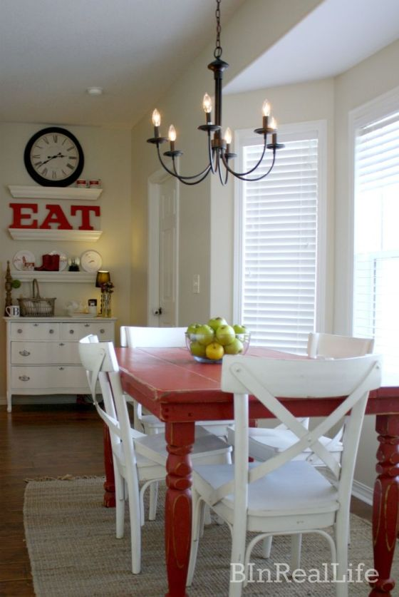 LOVE the red EAT and the red table. Also, how cute is that candle light chandelier? | Two Million Miles